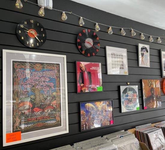 Wall with clocks and pictures